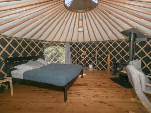 Interior of the Queen Yurt with a queen size bed