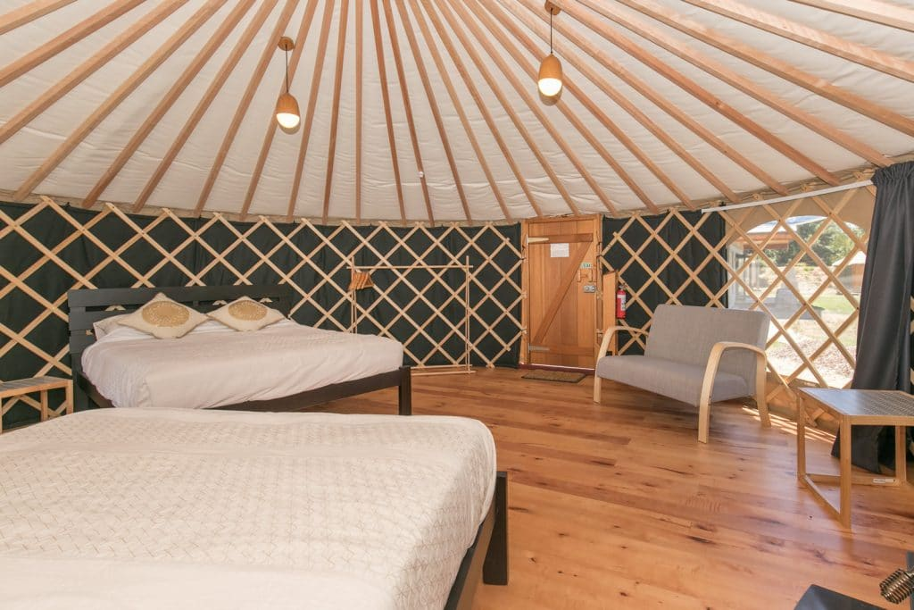 Interior of Queen Yurt with 2 queen size beds at Oasis Lodge Wanaka