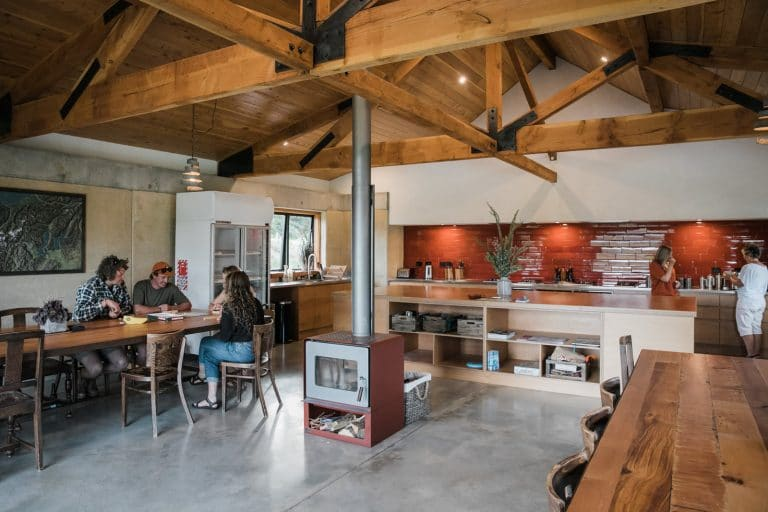 Group dining in communal dining & kitchen facilities at Oasis Yurt Lodge