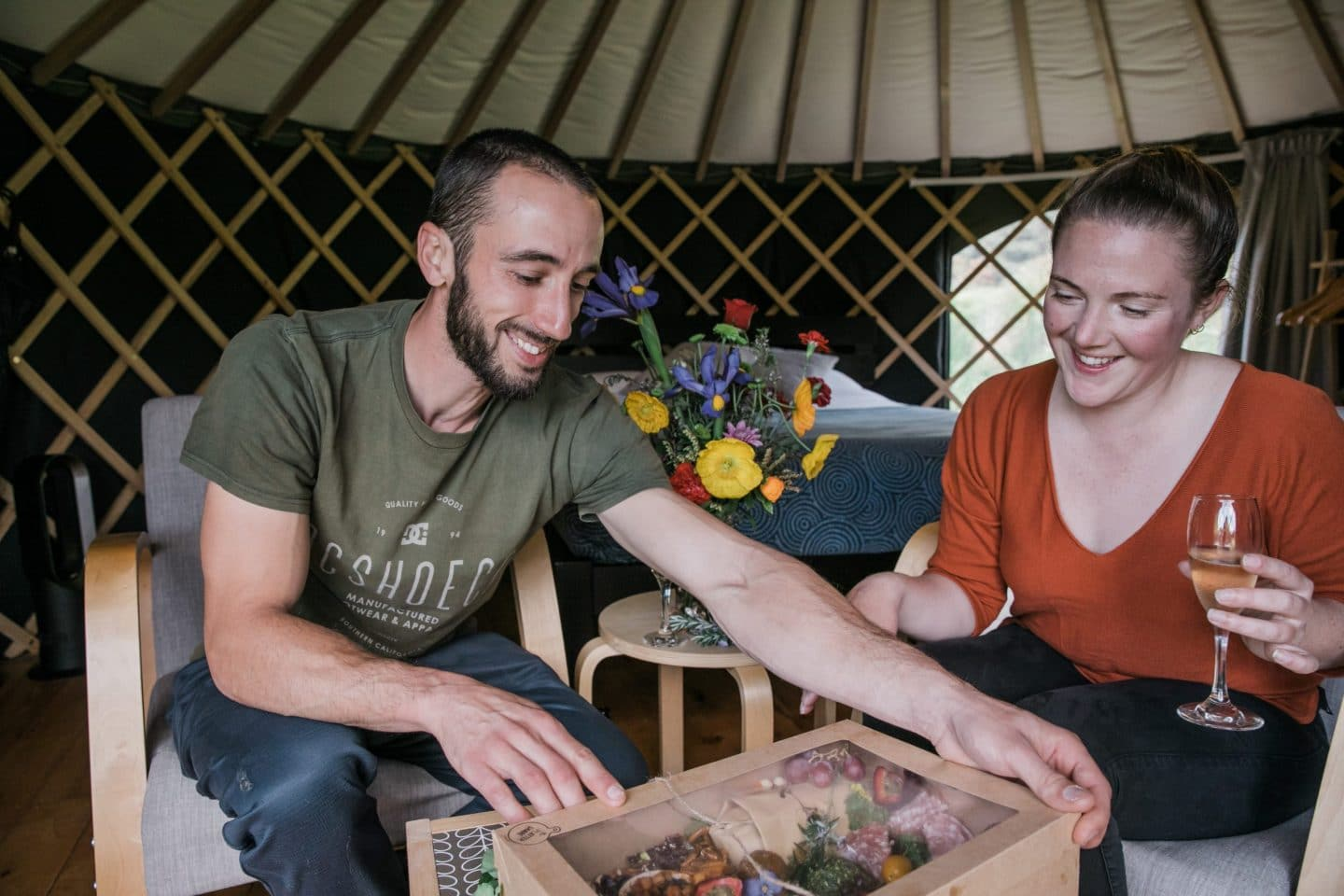 Couple with special occasion package inside yurt at Oasis Yurt Lodge Wanaka, NZ