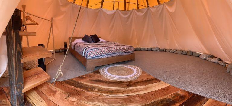 Queen tipi interior with queen bed