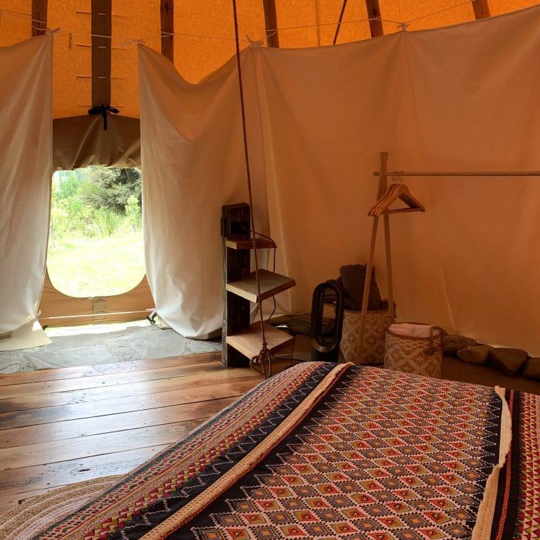 Interior of the queen tipi looking outside door
