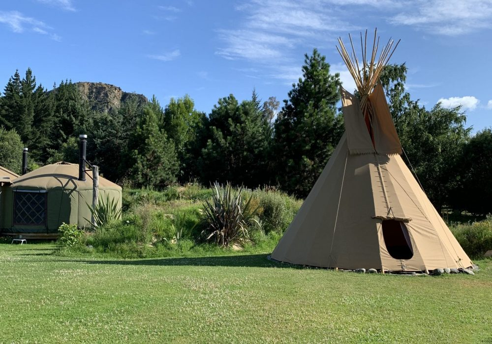 Outside area with queen tipi & yurt at Oasis Yurt Lodge
