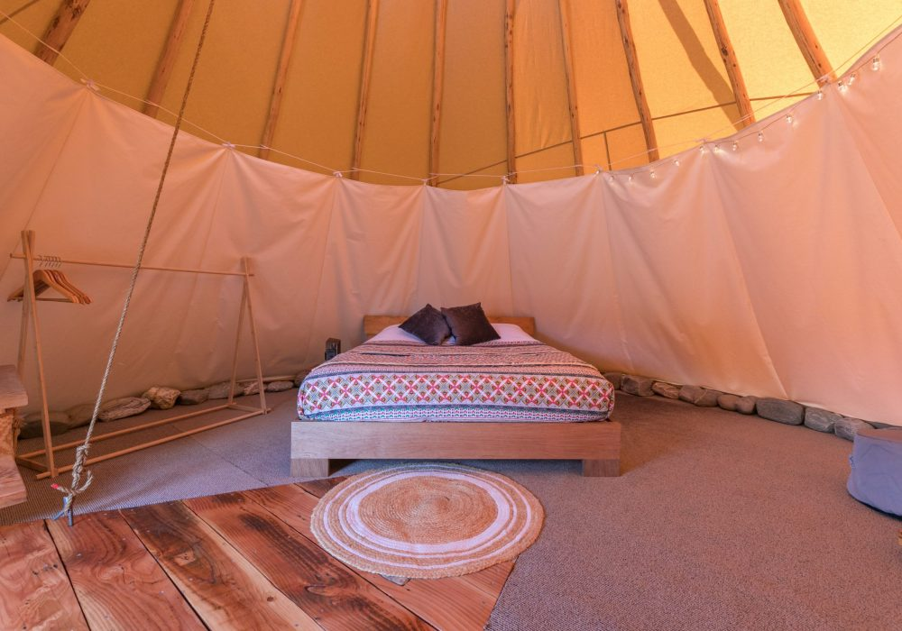 Interior of the queen tipi with a queen size bed