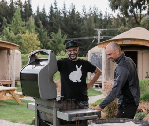 BBQ area by yurts outside at Oasis Yurt Lodge, Wanaka NZ